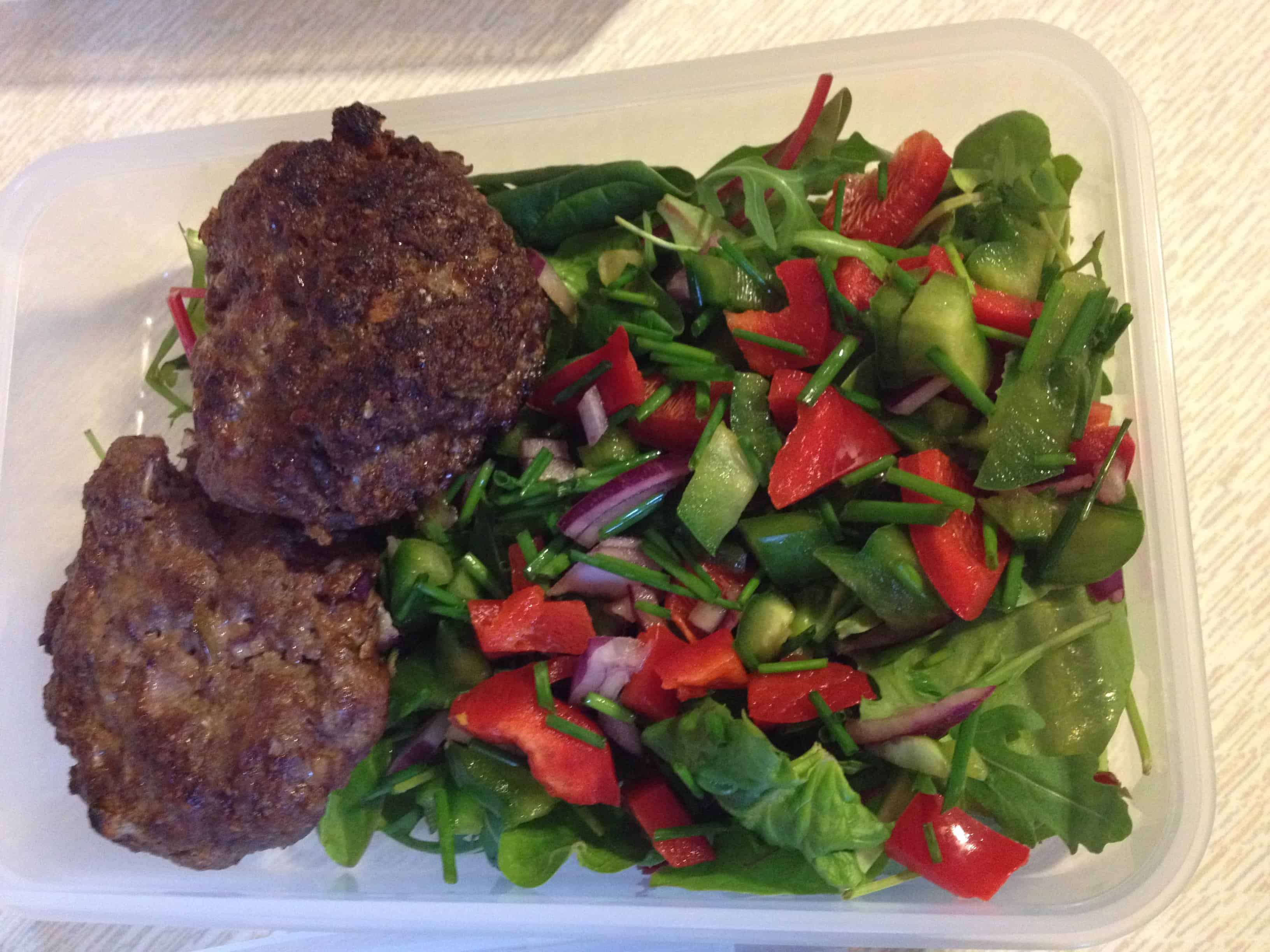 Home made burgers with a colourful salad